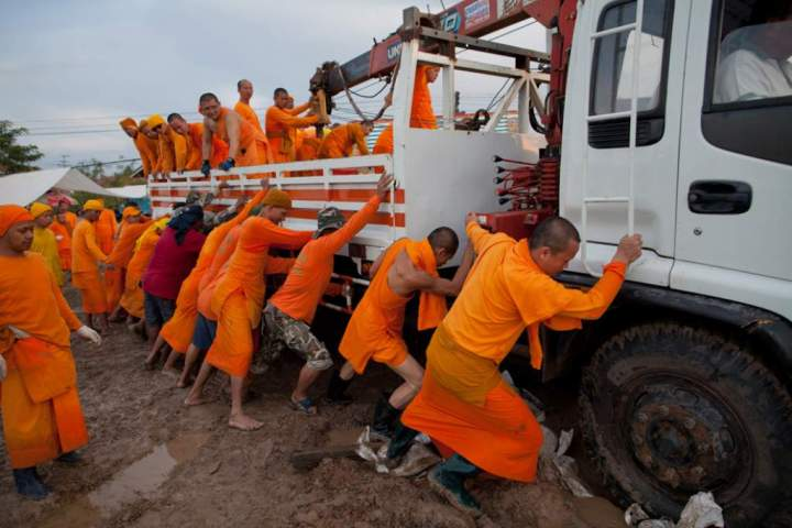 boston.com-monks pushing a truck